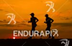 Runners at sunset at the Ironman World Championship in Kailua-Kona,…