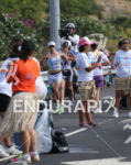 Mirinda Carfrae passes Mary Beth Ellis at a run aid…