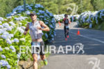 A tired Marcel Zamora running at the Ironman 70.3 Pucon…