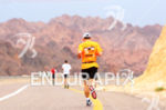 Triathlete running in the Arava Valley in direction of the…