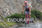 Javier Gomez climbs past the Clif House on his bike…