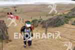 Pete Jacobs starts the climb of the sand stairs at…