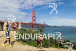 Athletes run past the Golden Gate Bridge at the 2013…