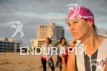Female triathlete observes the swim course prior to the race…
