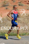 Ivan Vassiliev runs through Pioneer Park at the  Ironman 70.3…
