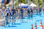 Bike pack crossing the classical ITU blue  transition area  at…