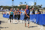 Carolina Routier (ESP) runs up beach toward transition after exiting…