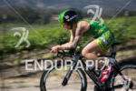 Heather Jackson chases down the leader on the bike at…