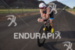 Paul Amey on bike at the 2013 Ironman 70.3 St.…