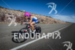 Margie Shapiro on bike at the 2013 Ironman 70.3 St.…