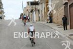 Age group athletes at a steep climb on the bike…