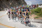 The front end of the yellow-jersey group heads over the…