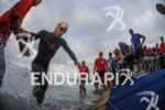 Mathias Hetch (GER) finishes is first swim loop at the…