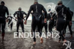 Athletes enter the water to start the swim during  the…