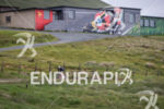 Athlete bikes past the Joey Dunlop memorial during the TT…