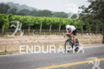 Martin Jensen rides past the many grape vineyards on the…