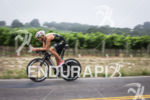 Jordan Rapp zooms by the many grape vineyards on the…