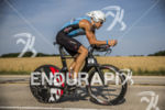 RYAN RAU on his bike at the 2013 Ironman Racine…