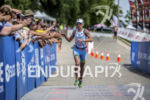 Mirinda Carfrae finishing at the 2013 Ironman Racine 70.3 on…