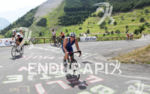 Age groupers on the bike climbing l'Alpe d'Huez
