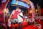 Amateur athlete kisses his partner on the finish line of…