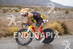 Craig Alexander riding in the rain at the 2013 Ironman…