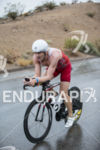 Tyler Butterfield riding in the rain at the 2013 Ironman…