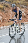 Andy Potts riding in the rain at the 2013 Ironman…