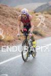 Timothy O'Donnell riding in the rain at the 2013 Ironman…