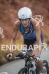 Kelly Williamson riding in the rain at the 2013 Ironman…