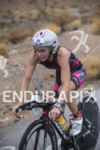 Magali Tisseyre riding in the rain at the 2013 Ironman…