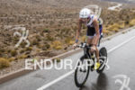 Leanda Cave riding in the rain at the 2013 Ironman…
