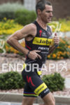 Craig Alexander on the run course at the 2013 Ironman…
