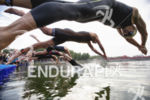 Pro men start the swim leg at the 2013 Beijing…
