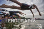 Pro women start the swim leg at the 2013 Beijing…