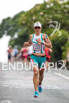 Ironman World Champion Mirinda Carfrae on the run course blazing…