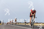 Timo Bracht competes during the bike portion of the 2013…