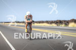 Mirinda Carfrae competes during the bike portion of the 2013…