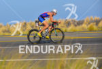 Leanda Cave rides her bike at the 2013 Ironman World…
