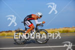 Matthew Russel riding at the 2013 Ironman World Championship in…