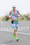 Dirk Bockel running at the 2013 Ironman World Championship in…
