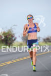 Gina Crawford running at the 2013 Ironman World Championship in…