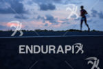 Age grouper running during the sunset at the 2013 Ironman…