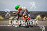 Ivan Rana (ESP) bikes along the lava fields at the…