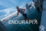 Helle Frederiksen jumps into the water at the 2013 Ironman…