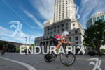 Terenzo Bozzone riding in downtown area at the 2013 Ironman…