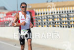 Terenzo Bozzone runs for victory at the 2013 Ironman 70.3…