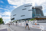 Triathlete running in front of the American Airlines Arena at…