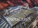 Finisher medals await their new owners at the finish line…