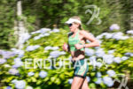 Dede Griesbauer running on the flower path at the 2014…